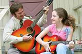Father Daughter Guitar Porch