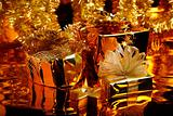Gold Christmas decoration with boxes and candle
