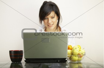 beautiful woman with laptop over white