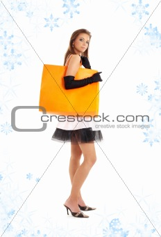 elegant lady with orange shopping bag and snowflakes