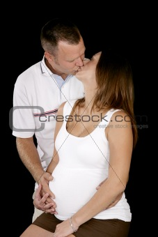 Expectant Parents Kiss