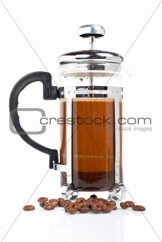 A coffee pot with beans