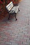 Wood Bench On Brick Walkway