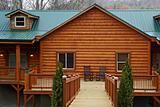Log Home With Green Tin Roof