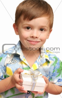 The nice boy holds a gift in hands
