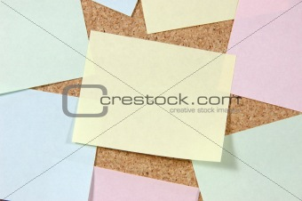 Close up of post-it notes on corkboard