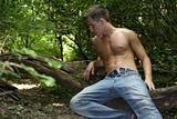 Shirtless male in jeans