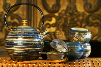 Blue oriental teapot with cups