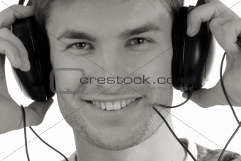 Portrait,  young guy in headphones for music