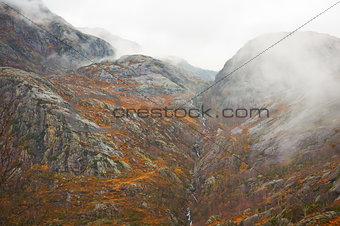Mountainside with descending mist