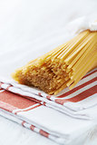 Spaghetti on white kitchen towel
