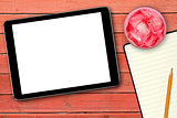 blank digital tablet on red wooden table
