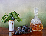 Slivovitz crystal bottle and plums