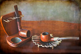 two vintage tobacco pipes with holder