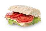 big sandwich with salami cheese tomato and salad leaves on ciabatta bread