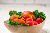 tomatoes on a wood bowl
