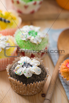 beautiful cup cakes muffins with baking background