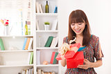 beautiful chinese woman happy receiving gift with lifestyle back