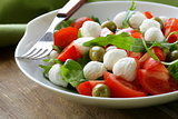 salad with olives, tomatoes and mozzarella cheese