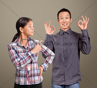 Asian Man and Girl Showing OK