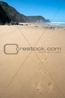 Foot prints in the sand on Cordama Beach, Portugal