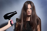 girl with hairdryer