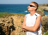 Handsome blond man enjoy Las Catedrales beach Ribadeo Spain