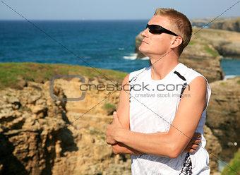 Handsome blond man enjoy Las Catedrales beach Ribadeo Spain