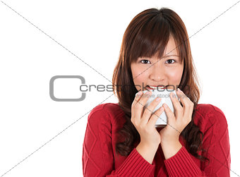 Asian woman drinking coffee or tea