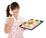 Thumb up Asian female baking