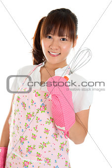 Asian girl holding egg beater