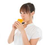 Asian woman drinking orange