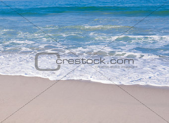Soft wave on the sandy beach