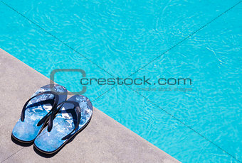 Flip-flops by the swimming pool