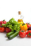 fresh vegetables and oil still life isolated