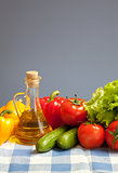 healthy food fresh vegetables still life on blue checked tablecl