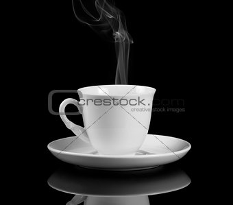 hot coffee cup with reflection on black