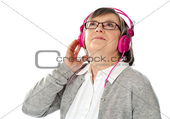 Old woman looking up, lost in musical world