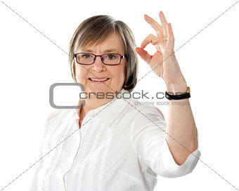 American lady gesturing excellence sign