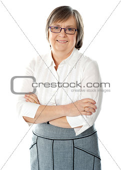 Smiling attractive old lady posing with arms crossed