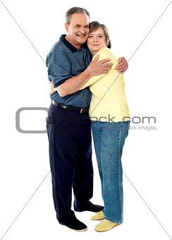 Portrait of happy couple hugging
