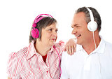 Romantic senior couple enjoying music together