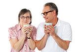 Happy matured couple holding cofee mug