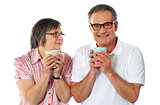 Romantic senior couple holding coffee mugs