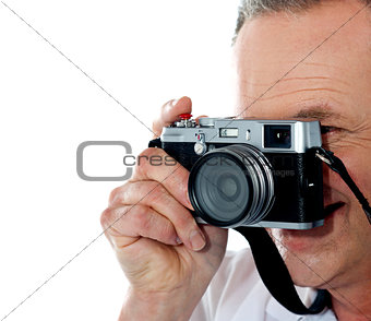 Cropped image of aged male photographer