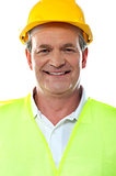 Smiling senior builder wearing hardhat