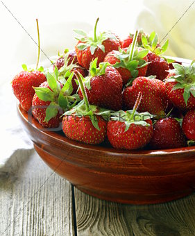 wooden bowl with ripe fresh strawberries