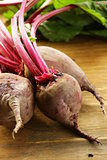fresh organic beets with leaves on a wooden background