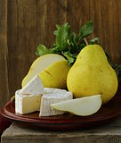piece of soft cheese with and pears  (brie, camembert)