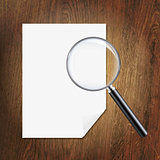 Wooden Background With Magnifying Glass And Paper